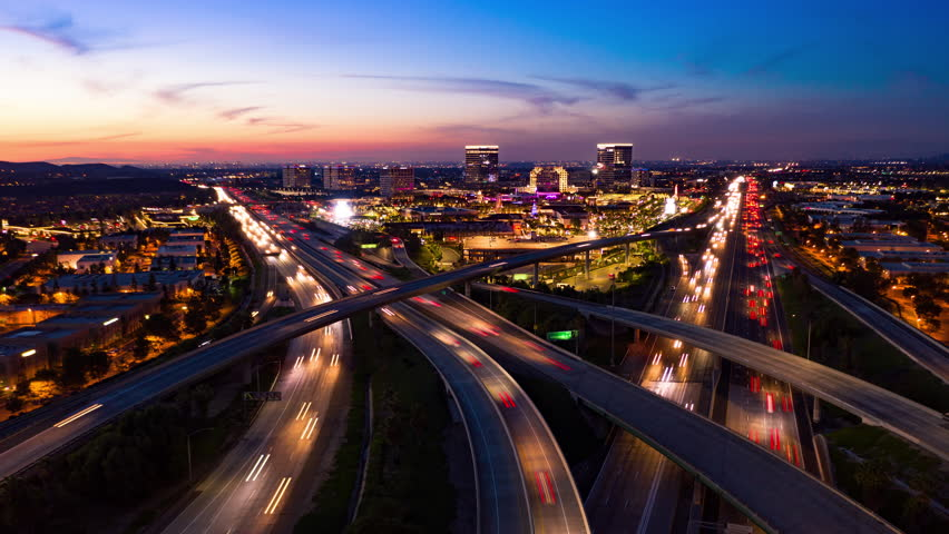 Aerial time lapse in motion drone shot of freeway and interstate traffic after sunset at night. | Shutterstock HD Video #1020718627