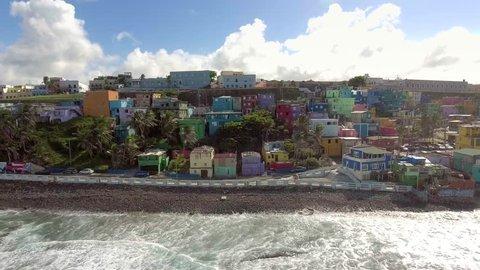 Aerial pan shot of La Perla in Old San Juan, Puerto Rico from the ocean.
