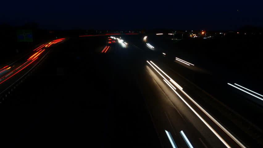 Busy time lapse traffic at night.  Seamless loop for use as a background