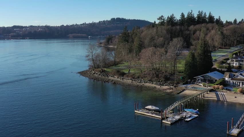 Aerial view over Burrard Inlet, ocean and island with boat and mountains in beautiful British Columbia. Canada. | Shutterstock HD Video #1020790447