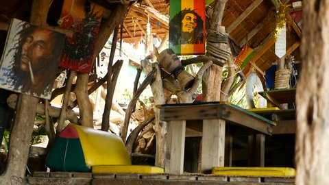 KOH SAMUI, THAILAND - SEPTEMBER 29, 2018 Relaxing jamaican cannabis rasta marijuana reggae bar on the tropical summer beach from. Rastafarian flags with yellow, red and green colors, bob marley.