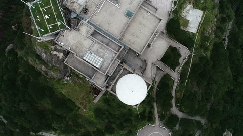 HUANGSHAN, CHINA - SEPTEMBER 2018: Overhead drone shot looking down on weather station located on the summit of a mountain in Huangshan national park in China