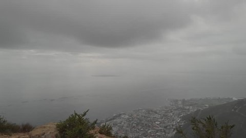 Aerial Shots ungraded shot at 60 fps with girl hiker at lions head mountain in Capetown, South Africa