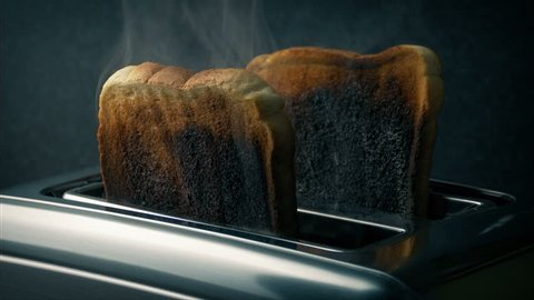 Burning Toast Pops Up In Toaster