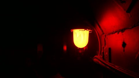 Air raid alarm signal with a red lamp turning on and off