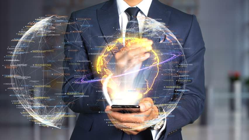 Businessman Hologram Concept Tech - EDUCATED | Shutterstock HD Video #1020897907