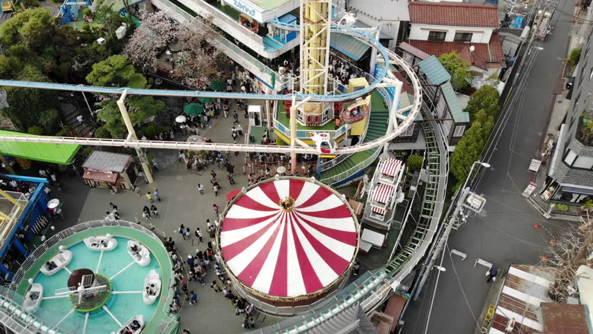 Aerial drone shot of a vintage Japanese amusement park in Tokyo | Shutterstock HD Video #1020988657