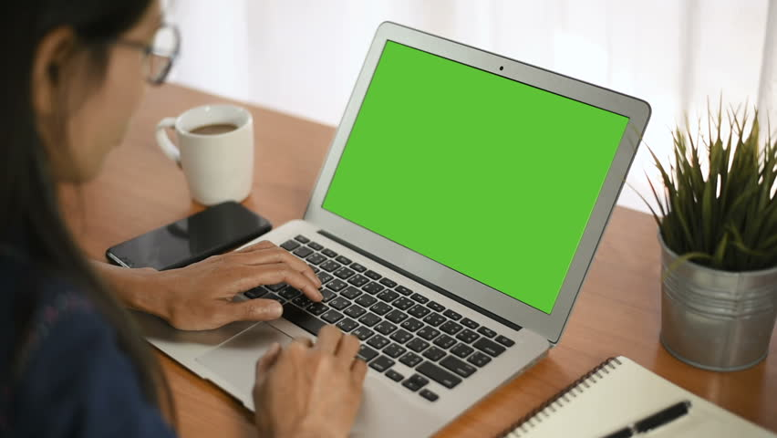 Young business start up, Young Owner Woman Start up for Business Online Working at home, Over the shoulder shot of a woman typing on a computer laptop with a key-green screen in home. | Shutterstock HD Video #1021001197