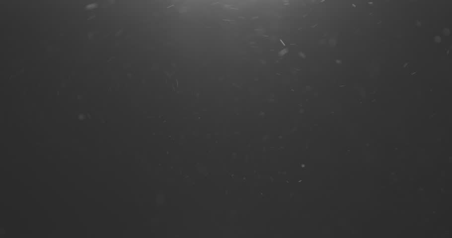 Dust particles explosive flow in the air with light leak from above | Shutterstock HD Video #1021057357