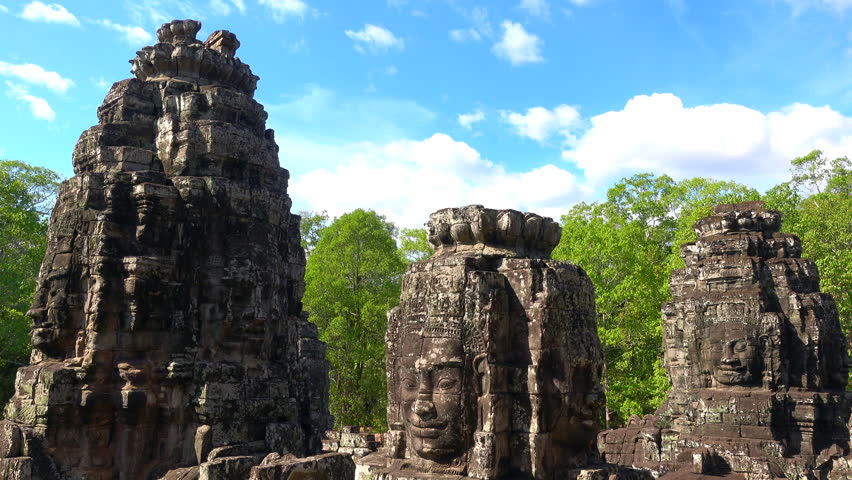 Faces of Bayon temple in Angkor Thom, Siemreap, Cambodia. The Bayon Temple (Prasat Bayon ) is a richly decorated Khmer temple at Angkor , ancient architecture in Cambodia #1021068397