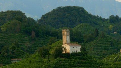 View of the green Prosecco wine hill, Saint Lorenz Church - Chiesetta di San Lorenzo, Farra di Soligo - Conegliano Valdobbiadene - Strada del Prosecco - Prosecco road