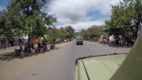 Arusha - tanzania / march 2016: driving through the streets of northern  tanzanian village near arusha city