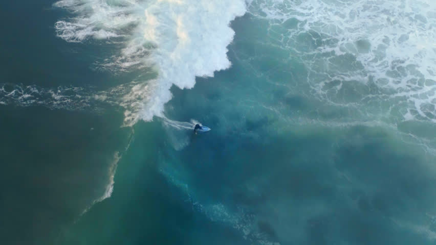 Aerial shot of a person surfing  | Shutterstock HD Video #1021151347