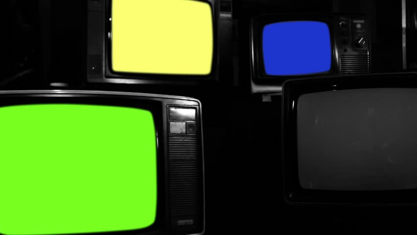 """Old Tvs Turning On Different Chroma Screen. BW Tone. Zoom Out. Ready to Replace Chroma Screens with any Footage or Picture you Want. You can do it with """"Keying"""" (Chroma Key) effect. 