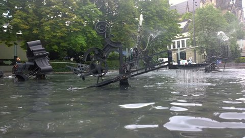 Basel, Switzerland-June 30, 2018:  Kinetic fountain of the Swiss sculptor Jean Tinguely. Time lapse.