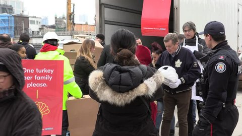 Toronto, Ontario, Canada December 2018 Volunteers hand out free food and turkeys to people at Christmas in Toronto