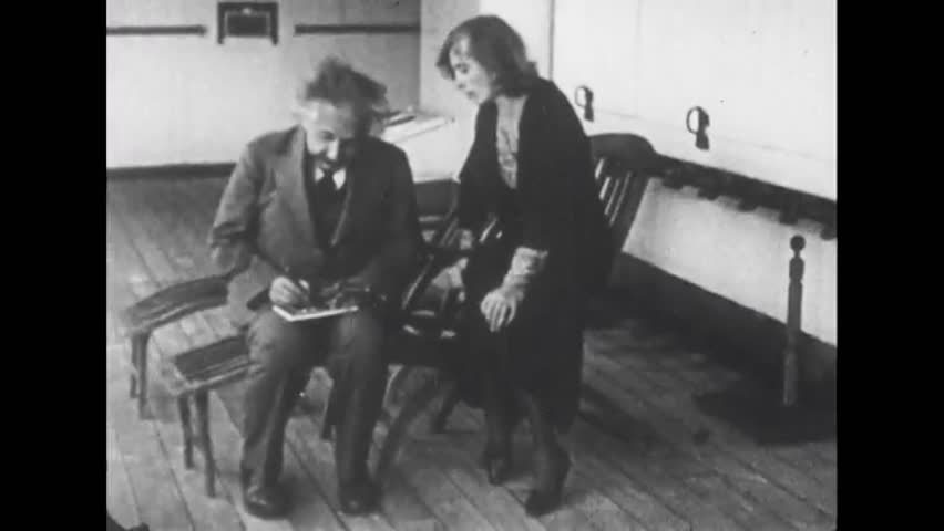 California, United State of America. About 1935. Albert Einstein writes in the company of a woman and his wife