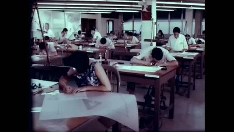 CIRCA 1960s - People work making maps of Central and South America for the US army in the 1960s -