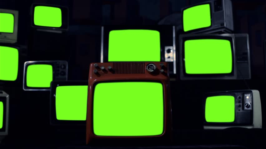 "Vintage Tvs Turning On Green Screens. Night Tone. Ready to replace greens screen with any footage or picture you want. You can do it with ""Keying"" (Chroma Key) effect. 