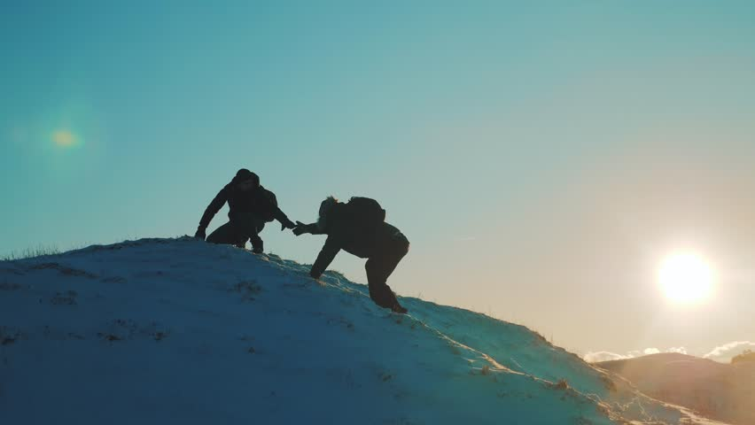 Teamwork business travel concept. two hikers tourists climbers climb to the top of the mountain. overcoming hardships the path to victory, teamwork, important points in lifestyle running your business | Shutterstock HD Video #1021321327