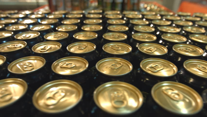 Beer in supermarket. Many cans of beer are on counter in the store. | Shutterstock HD Video #1021427347