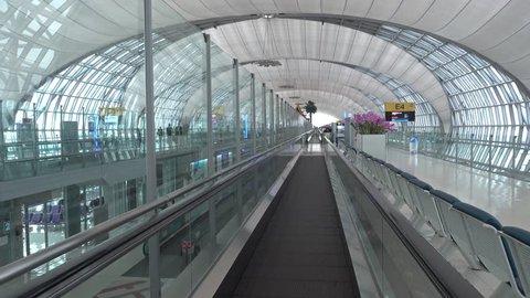 BANGKOK, THAILAND - CIRCA JAN 2018: Moving inside of Suvarnabhumi Airport. Suvarnabhumi Airport is one of two international airports serving Bangkok, 4k