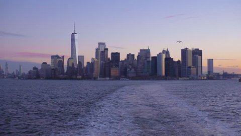 Manhattan Urban Cityscape, Seagulls and Bay at Morning Twilight. New York City. View From the Boat. Unites States of America