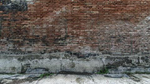 4K Animation of Broken Old Grunge Dirty Brick Wall with Green Screen. 3D Rendering