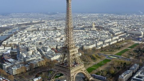 Aerial View Eiffel Tower World's Most Iconic Monument. Orbiting and Flying by around the Famous European Landmark in Popular Tourist Travel Destination Paris, France HD - 4K