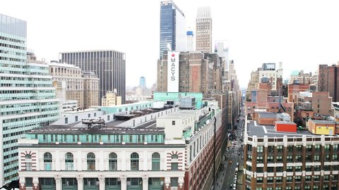 New York City, USA - April 7, 2018: High angle, aerial view of urban cityscape, skyline from building rooftop on skyscrapers in NYC Herald Square Midtown with Macy's store sign at 34th street