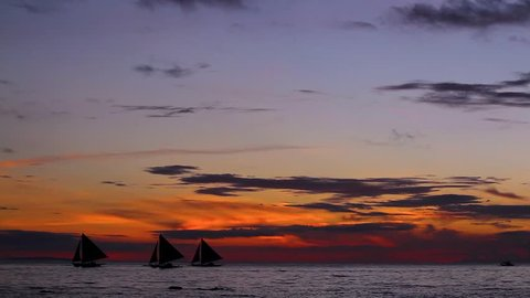 3 Sail Boats Sailing off at Sunset Eve Boracay Philippines