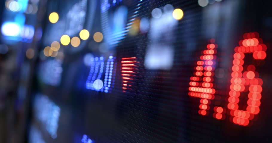 Stock market number display in the city at night   Shutterstock HD Video #1021776097