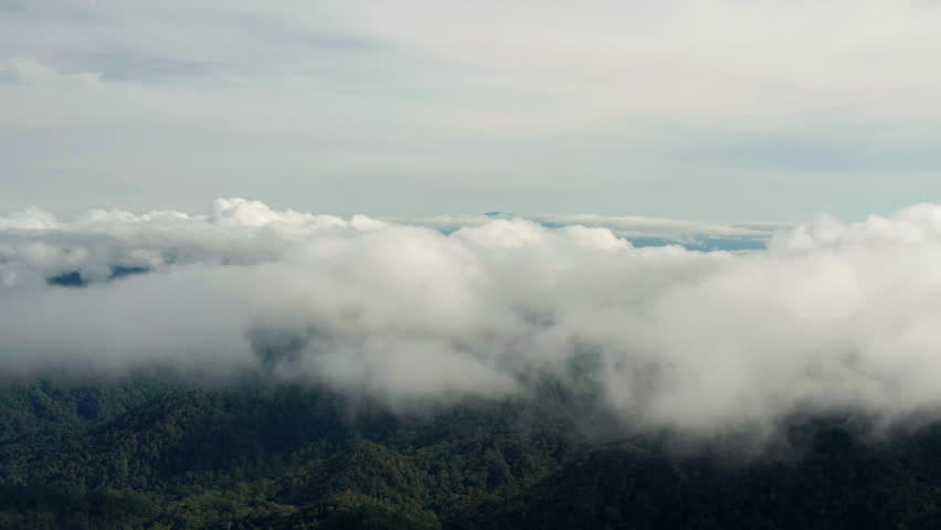 Aerial view of clouds float above the  mountains near Genting Highlands, Malaysia | Shutterstock HD Video #1021791157