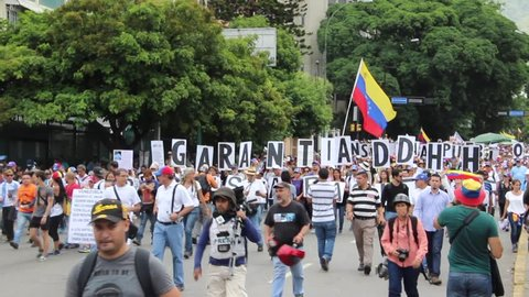 Caracas/Venezuela-June 27, 2017. Protestors against dictatorship Nicolas Maduro hold up signs for human rights at a protest march