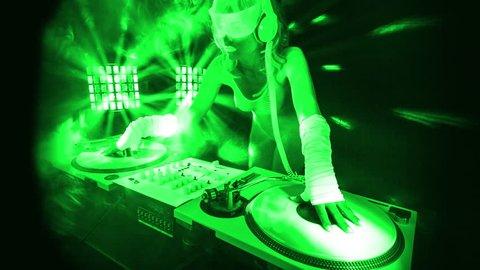 fantastic video of sexy cyber DJ woman filmed in fluorescent clothing under UV black light