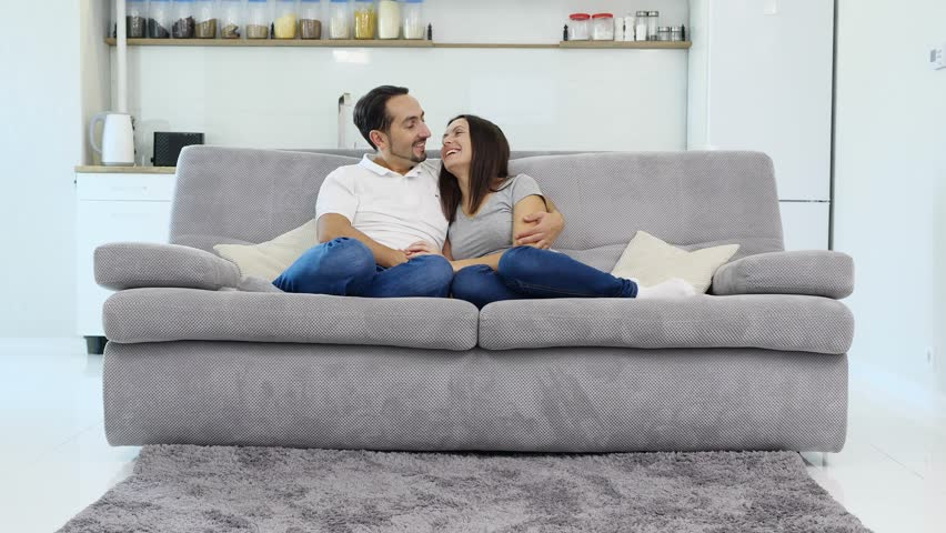 The husband and wife have fun on the couch  | Shutterstock HD Video #1022025967