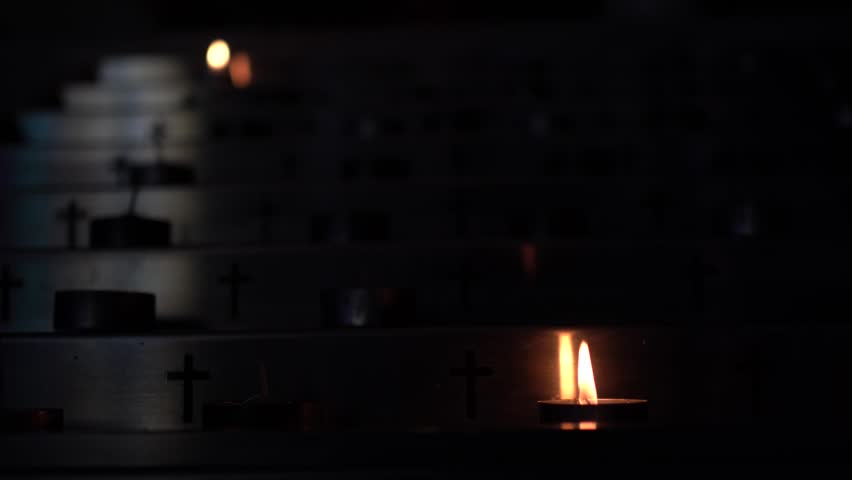 Metal candlestick with candle in the church.  Close up. | Shutterstock HD Video #1022032447