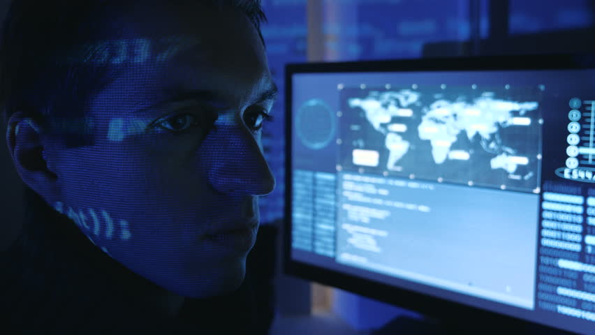 Close-up portrait of a Man Professional IT Programmer working at computer in a data center filled with monitor screens | Shutterstock HD Video #1022084977