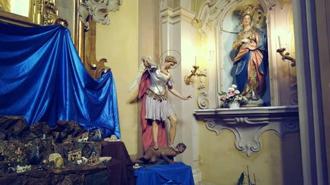 LUGO (RA), ITALY - DECEMBER 22: lights are enlightening statues of  The Blessed Virgin Mary and Archangel Michael in Pius Suffrage Church