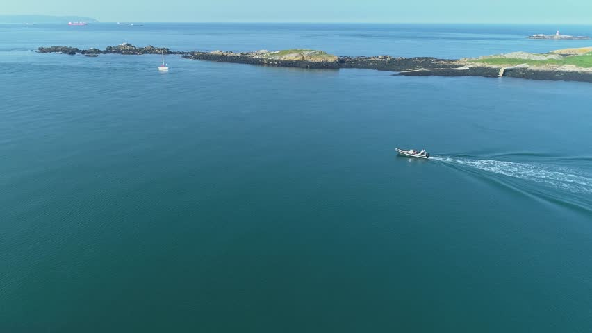 Gorgeous 4K drone shot of a boat slowly travelling near the coast at Dalkey, Dublin, Ireland. | Shutterstock HD Video #1022132197
