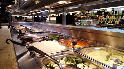 FULHAM, LONDON - JANUARY 8, 2018: Hot food buffet in the self service section of Whole Foods Market in Fulham, West London, UK.