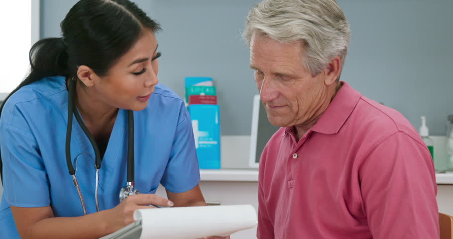 Doctor Or Nurse Talking To Stock Footage Video 100 -4371