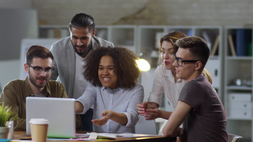 Group of ecstatic multiethnic business people looking at laptop computer screen and celebrating success   Shutterstock HD Video #1022245087