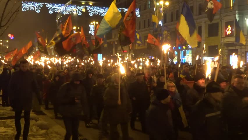 Torchlight procession (torch march) of Ukrainian nationalists with a portrait of their leader Bandera. Kiev, Ukraine. January 1, 2019 #1022344897