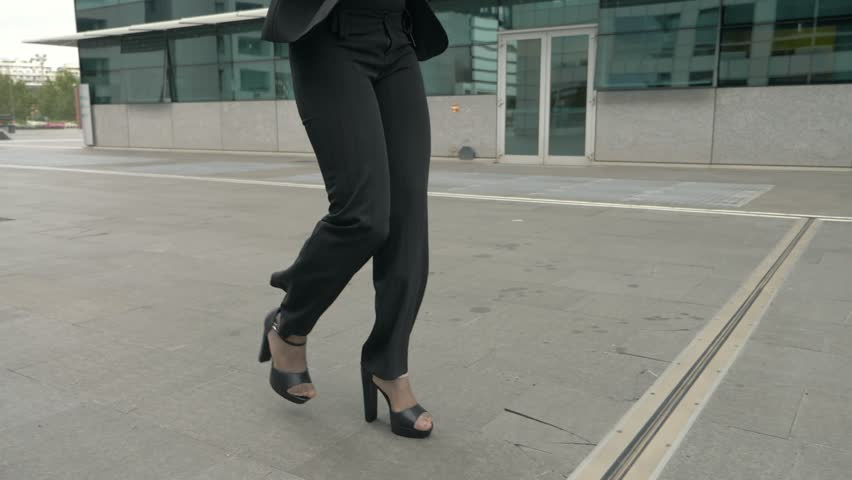 Beautiful Young Business Woman Walking Outside On The street. Close Up Of Legs | Shutterstock HD Video #1022365927