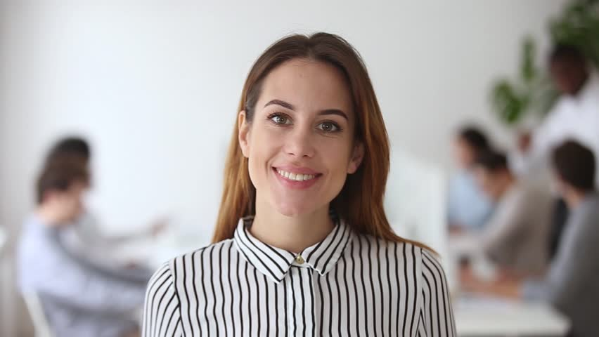 Video portrait of happy female business leader successful millennial businesswoman posing in office with team, smiling professional administrator young executive confident lady boss looking at camera