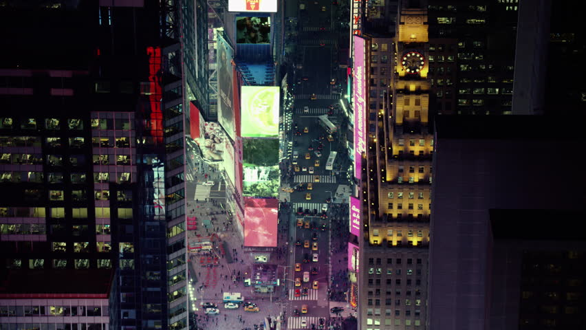 Aerial view of busy streets of Times Square with billboards and advertisements I created, New York City, at night in winter. Shot on 4k RED camera on helicopter