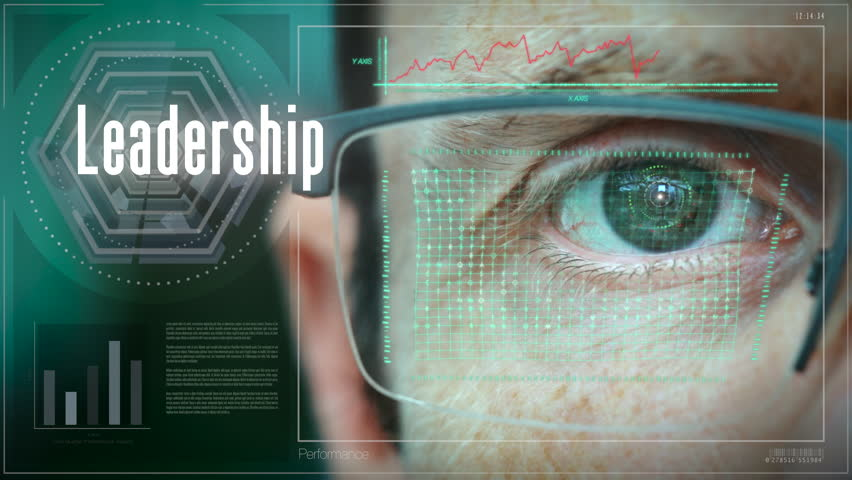 A close up of a businessman eye controlling a futuristic computer system with a Business Leadership concept.