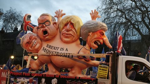 LONDON, circa 2019 - Close-up shot of a Pro-EU float representing Theresa May, Boris Johnson, Michael Gove and Michael Farage in a bid to stop BREXIT. With ambient sound.