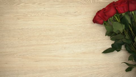 Bunch of roses isolated on wooden background, Valentines Day template, top view